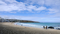 BNPS.co.uk (01202) 558833. <br /> Pic: KnightFrank/BNPS<br /> <br /> Pictured: Porthmeor Beach. <br /> <br /> The ultimate room with a view...<br /> <br /> A former fish cellar that is now an idyllic waterfront home overlooking a famous Cornish beach is on the market for £930,000.<br /> <br /> The ground floor apartment is in a prime frontline position with exceptional panoramic views over Porthmeor Beach and out to sea.<br /> <br /> Estate agent Christopher Bailey said the window in the reception space is like having your own live television screen looking out on the action of the beach.<br /> <br /> It has been designed and renovated to an exceptionally high standard and the immaculate flat is currently rented out for short holiday let, making about £40,000 profit a year.