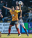 Partick's Lyle Taylor holds off Dundee's Jim McAlister.
