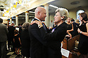 Mayor Mitch Landrieu consoles Cokie Roberts as family, friends and well-known politicians say goodbye to former US Rep. Lindy Boggs during her funeral at St. Louis Cathedral, New Orleans, Aug. 1, 2013.