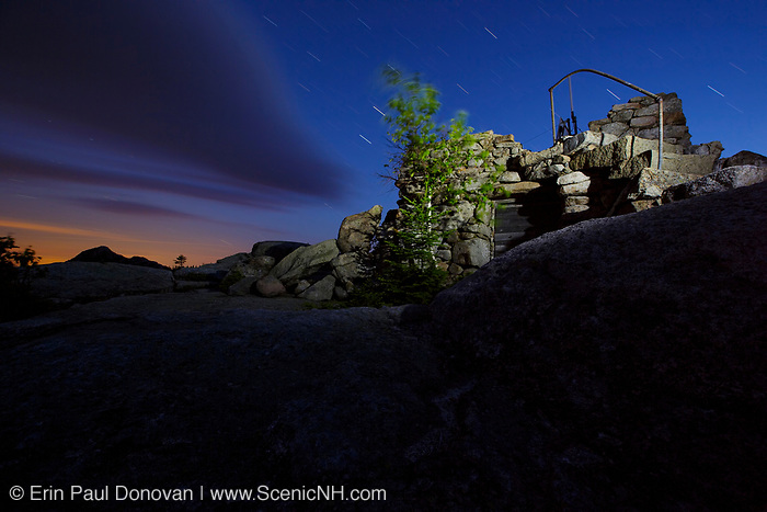 Middle Sister Fire tower on Middle Sister Mountain in Albany, New Hampshire USA during a summer night. This fire tower was in operation from 1927-1948.