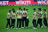 The Black Caps celebrate a wicket during the third international men's T20 cricket match between the New Zealand Black Capss and Australia at Sky Stadium in Wellington, New Zealand on Wednesday, 3 March 2021. Photo: Dave Lintott / lintottphoto.co.nz