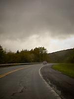 Patrol car seen through rainy windshield<br />