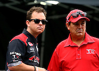 Sept. 1, 2013; Clermont, IN, USA: NHRA top fuel dragster driver Billy Torrence (right) talks with Steve Torrence during qualifying for the US Nationals at Lucas Oil Raceway. Mandatory Credit: Mark J. Rebilas-
