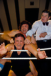Mick McManus wrestling with Maxine who is twisting his ears, at the Assembly Rooms, Derby Derbyshire December 1980