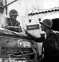 Lt. Col. Lyle Bernard, CO, 30th Inf. Regt., a prominent figure in the second daring amphibious landing behind enemy lines on Sicily's north coast, discusses military strategy with Lt. Gen. George S. Patton.  Near Brolo.  1943.   (Army)<br /> Exact Date Shot Unknown<br /> NARA FILE #:  111-SC-246532<br /> WAR & CONFLICT BOOK #:  1024