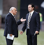 Jim Traynor and Craig Mather having a heated discussion trackside at Airdrie