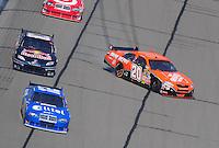 Sept. 28, 2008; Kansas City, KS, USA; Nascar Sprint Cup Series driver Tony Stewart (20) spins after contact with Brian Vickers (83) during the Camping World RV 400 at Kansas Speedway. Mandatory Credit: Mark J. Rebilas-
