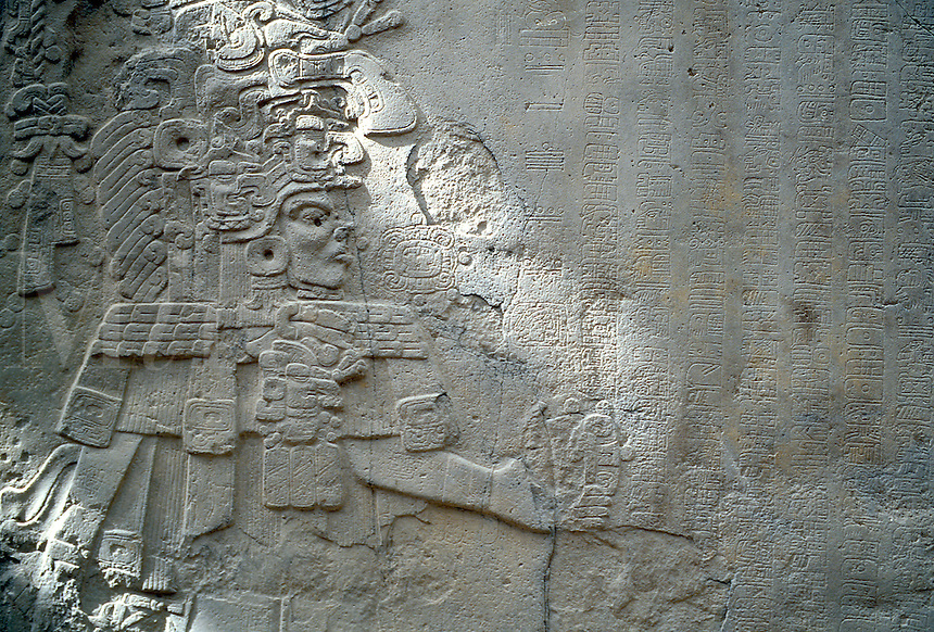 Stele relief sculpture of a Mexican God figure and pictograms carved into stone. Museo de Antropologia (Museum of Anthropology, Xalapa (Jalapa) Veracruz, Mexico.