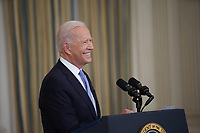 U.S. President Joe Biden smiles while speaking in the State Dining Room of the White House in Washington, D.C., U.S., on Friday, Sept. 24, 2021. The U.S. will begin giving Covid-19 booster shots to millions of Americans today, a watershed moment in the nation's battle against the pandemic that officials hope will beat back another brutal winter wave of infections. <br /> Credit: Al Drago / Pool via CNP /MediaPunch