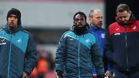 STOKE, ENGLAND - DECEMBER 2: Wayne Routledge of Swansea City and Nathan Dyer and Swansea City goalkeeper coach Tony Roberts after the final whistle of the Premier League match between Stoke City and Swansea City at the bet365 Stadium on December 2, 2017 in Stoke, England. (Photo by Athena Pictures/Getty Images)