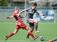 20140419 - ANTWERPEN , BELGIUM : Standard's Maud Coutereels (right) pictured being tackled by Antwerp Stefanie Van Broeck (left) during the soccer match between the women teams of RAFC Antwerp Ladies  and Standard Femina  , on the 24th matchday of the BeNeleague competition on Saturday 19 April 2014 in Deurne .  PHOTO DAVID CATRY