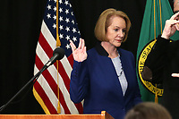 "Seattle Mayor Jenny Durkan makes the ""Live long and prosper"" Vulcan salute after speaking at a news conference to announce measures to combat the spread of novel coronavirus, COVID-19, in Seattle, Washington, U.S. March 11, 2020.  REUTERS/Karen Ducey"