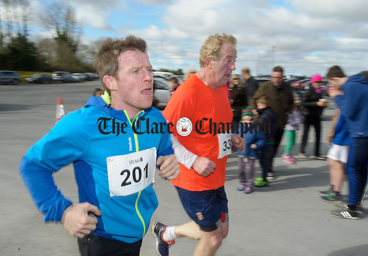Richie Pyne and PJ Lynch of head for the line at the Hurley-Hoey Memorial 10km run, walk and cycle which started at St Joseph's Doora Barefield complex at Gurteen. Photograph by John Kelly.