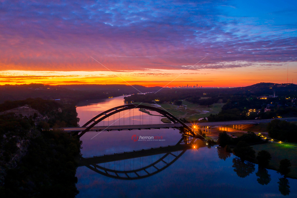 Although I'm not known to be a morning person, I woke up early this freezing cold morning and decided to take my drone for a flight and what did I find, but an insanely beautiful sunrise overlooking the Austin 360 Bridge (otherwise known as Pennybacker Bridge) as steam rose up from Lake Austin. As the saying goes, the early bird gets the worm!