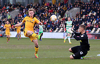 Alex Samuel of Newport County attempts to chip keeper Jonny Maddison of Yeovil Town during the Sky Bet League Two match between Newport County and Yeovil Town at Rodney Parade, Newport, Wales, UK. 14 April 2017