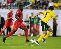 NASHVILLE, TN - JULY 3: Jozy Altidore #17 attacks with the ball against Michael Hector #3 during a game between Jamaica and USMNT at Nissan Stadium on July 3, 2019 in Nashville, Tennessee.