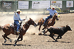 Jessie Nuttal and Dennis Lee compete in the team roping event at the Minden Ranch Rodeo on Saturday, July 23, 2011, in Gardnerville, Nev..Photo by Cathleen Allison