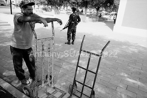 """Linares, Mexico<br /> June 6, 2007<br /> <br /> The Mexican government has placed 30,000 military, primarily in the north of the country, to combat crime and drug trafficking. The military opens the """"food for weapons"""" program in the small town of Linares. """"Arm yourself with values, not with weapons"""" is the motto. Owning a weapon in Mexico is a crime. The military has been operating this program for the past few months and have collected about 1,000 weapons, including grenades."""