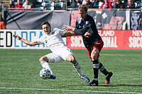 FOXBOROUGH, MA - MARCH 7: Przemyslaw Frankowski #11 of Chicago Fire controls the ball as he falls during a tackle by Henry Kessler #4 of New England Revolution during a game between Chicago Fire and New England Revolution at Gillette Stadium on March 7, 2020 in Foxborough, Massachusetts.