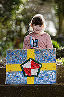 Pictured: Elly Neville with the The British Citizen Award for the Good of the Country and the flag she created at her home in Pembroke, west Wales, UK. Tuesday 20 February 2018<br /> Re: Seven-year-old Elly Neville who was born despite doctors saying her parents would not be able to have any more children, has raised over £150,000 for the cancer ward that treated her father.<br /> Her parents Lyn and Ann had been told they were unlikely to have more children after he underwent a bone marrow transplant in 2005. <br /> Mr Neville subsequently spent a lot of time on the Ward 10 cancer facility at Withybush Hospital in Haverfordwest, Pembrokeshire.<br /> But four years later they were stunned when his painter and decorator wife Ann fell pregnant again.