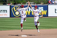 Wisconsin Timber Rattlers shortstop Hayden Cantrelle (2) and second baseman David Hamilton (1) high-five following a game against the West Michigan Whitecaps on May 22, 2021 at Neuroscience Group Field at Fox Cities Stadium in Grand Chute, Wisconsin.  (Brad Krause/Four Seam Images)