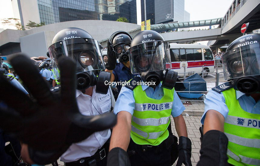Riot police are seen near the Hong Kong government headquarters in Hong Kong's downtown district, on the first day of the mass civil disobedience campaign Occupy Central, Hong Kong, China, 28 September 2014.