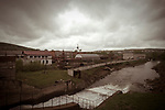 A dam ,on the background there is the Arty mechanical plant. Russia, Sverdlovsk Oblast, Arty village, May 2009