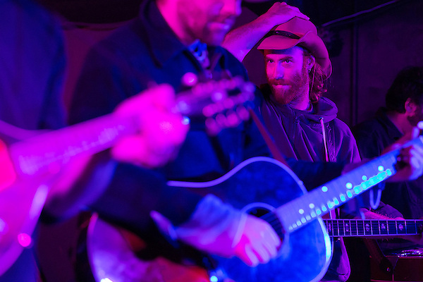 November 8, 2013. Chapel Hill, North Carolina.<br />  Luke Mallett resets his hat during the band's set.<br />  The Mallett Bros. Band played a 2.5 hour set at the Kraken on the last leg of a 6 week tour of the US, before heading for a wedding in Maryland and then their last show in Nashville, where they will open for their father.