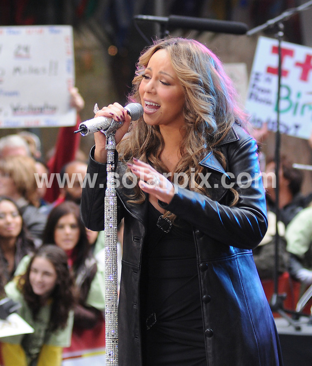 """**ALL ROUND PICTURES FROM SOLARPIX.COM**.**SYNDICATION RIGHTS FOR UK, AUSTRALIA, DENMARK, PORTUGAL, S. AFRICA, SPAIN & DUBAI (U.A.E) ONLY**.Pop singer Mariah Carey in Concert on NBC's """"Today Show"""" at the Rockefeller Center in New York City, NY, USA ..This pic:Mariah Carey..JOB REF:10052     PHZ/Mayer    DATE: 02.10.09.**MUST CREDIT SOLARPIX.COM OR DOUBLE FEE WILL BE CHARGED**.**MUST NOTIFY SOLARPIX OF ONLINE USAGE**.**CALL US ON: +34 952 811 768 or LOW RATE FROM UK 0844 617 7637**"""