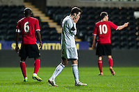 Monday 20 January 2014<br /> Pictured: Sam Evans holds his head in his hands<br /> Re: Swansea City U21 v Cardiff City U21 at the Liberty Stadium, Swansea Wales