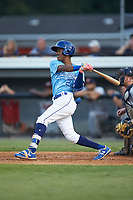 Maikel Garcia (2) of the Burlington Royals follows through on his swing against the Danville Braves at Burlington Athletic Stadium on August 9, 2019 in Burlington, North Carolina. The Royals defeated the Braves 6-0. (Brian Westerholt/Four Seam Images)