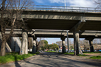 Corso Francia viaduct (by Pier Luigi Nervi).<br /> <br /> Rome, 18/03/2020. Rome's Olympic Village district under the Italian Government lockdown for the Outbreak of the Coronavirus SARS-CoV-2 - COVID-19. On 22 March, the Italian PM Giuseppe Conte signed a new Decree Law which suspends non-essential industry productions and contains the list of allowed working activities, which includes Pharmaceutical & food Industry, oil & gas extraction, clothes & fabric, tobacco, transports, postal & banking services (timetables & number of agencies reduced), delivery, security, hotels, communication & info services, architecture & engineer, IT manufacturers & shops, call centers, domestic personnel (1.).<br /> Updates: Italy: 22.03.20, 6:00PM: 46.638 positive cases; 7.024 recovered; 5.476 died.<br /> <br /> The Rome's Olympic Village (1957-1960) was designed by: V. Cafiero, A. Libera, A. Luccichenti, V. Monaco, L. Moretti. «Built to host the approximately 8,000 athletes involved in the 1960 Olympic Games, Rome's Olympic Village is a residential complex located between Via Flaminia, the slopes of Villa Glori and Monti Parioli. It was converted into public housing [6500 inhabitants, ndr] at the end of the sporting event. The intervention is an example of organic settlement, characterized by a strong formal homogeneity, consistent with the Modern Movement's principles of urbanism. The different architectural structures are made uniform by the use of some common elements: the pilotis, ribbon windows, concrete stringcourses, and yellow brick curtain covering. At the center of the neighborhood, the Corso Francia viaduct - a road bridge about one kilometer long - was built by P.L. Nervi[…]» (2.).<br /> <br /> Info COVID-19 in Italy: http://bit.do/fzRVu (ITA) - http://bit.do/fzRV5 (ENG)<br /> 1. March 22nd Decree Law http://bit.do/fFwJn (ITA)<br /> 2. (Atlantearchitetture.beniculturali.it MiBACT, ITA - ENG) http://bit.do/fFw3H<br /> 12.03.20 Rome's Lockdown for the Outbreak of the Coron