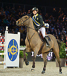Jacqueline Lai during the HKJC Race of the Rider during the Longines Masters of Hong Kong on 19 February 2016 at the Asia World Expo in Hong Kong, China. Photo by Li Man Yuen / Power Sport Images