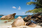 Seychelles, Island Praslin, Anse Takamaka: beach, granite rocks and palm tree<br />