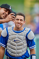 Austin Barnes (10) of the Oklahoma City Dodgers poses for a photo with a fan before the game against the Salt Lake Bees at Smith's Ballpark on July 31, 2019 in Salt Lake City, Utah. The Dodgers defeated the Bees 5-3. (Stephen Smith/Four Seam Images)