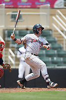 Evan Skoug (11) of the Kannapolis Intimidators follows through on his swing against the Hagerstown Suns at Kannapolis Intimidators Stadium on July 17, 2018 in Kannapolis, North Carolina. The Intimidators defeated the Suns 10-9. (Brian Westerholt/Four Seam Images)