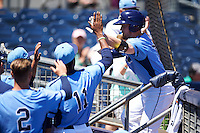 Charlotte Stone Crabs designated hitter Riley Unroe (7) high fives Damion Carroll (11) after scoring a run during a game against the Palm Beach Cardinals on April 10, 2016 at Charlotte Sports Park in Port Charlotte, Florida.  Palm Beach defeated Charlotte 4-1.  (Mike Janes/Four Seam Images)