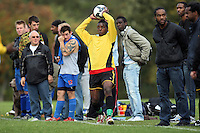 A large crowd watches as a Hackney Downs FC player takes a throw-in during an East London Sunday League match at Hackney Marshes - 11/10/09 - MANDATORY CREDIT: Gavin Ellis/TGSPHOTO - Self billing applies where appropriate - Tel: 0845 094 6026