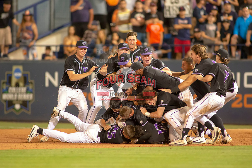 University of Washington Huskies celebrate their tenth inning walk off win and their berth into the College World Series at Goodwin Field on June 10, 2018 in Fullerton, California. The Huskies defeated the Titans 6-5. (Donn Parris/Four Seam Images via AP Images)