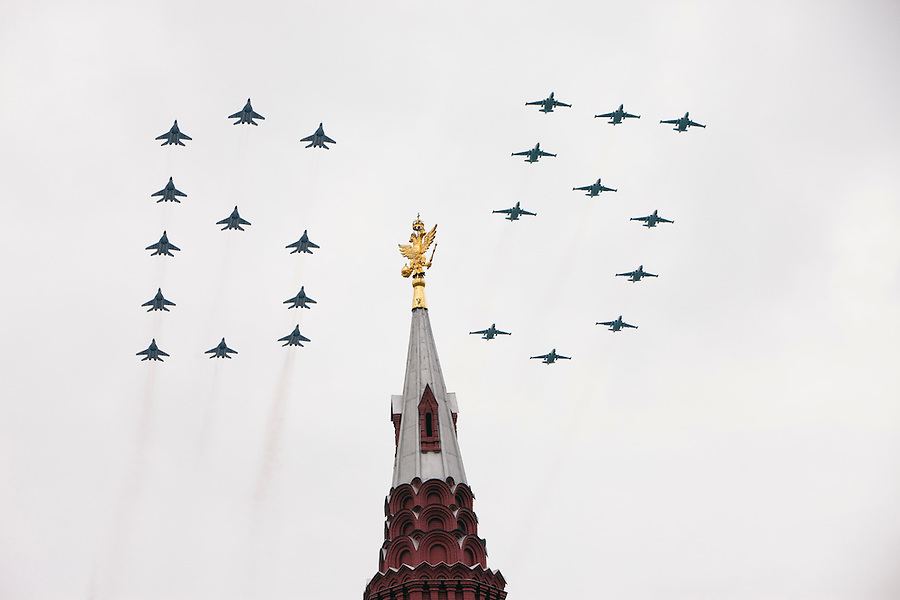 Moscow, Russia, 06/05/2010..Russian MiG-29 SMT and Su-25 SM jets fly in formation making the number 65 over a Kremlin spire during a Red Square rehearsal for the forthcoming May 9 65th Victory Day parade, scheduled to be the largest for many years.