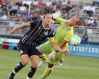 Abby Wambach #20 of the Washington Freedom and Jillian Loyden #1 of the Chicago Red Stars go after a loose ball during a WPS match at Maryland Soccerplex on August 19 2010, in Boyds, Maryland. Freedom won 2-0.
