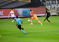 LOS ANGELES, CA - SEPTEMBER 02: Bradley Wright-Phillips #66 of the Los Angeles Football Club takes a shot past Daniel Vega #17 GK of the San Jose Earthquakes and scores during a game between San Jose Earthquakes and Los Angeles FC at Banc of California stadium on September 02, 2020 in Los Angeles, California.