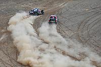 7th January 2021; Riyadh to Buraydah, Saudi Arabia; Dakar Rally, stage 5;  #300 Sainz Carlos (esp), Cruz Lucas (esp), Mini, X-Raid Mini JCW Team, Auto, #307 Przygonski Jakub (pol), Gottschalk Timo (deu), Toyota, Overdrive Toyota, Auto, action during the 5th stage of the Dakar 2021 between Riyadh and Al Qaisumah, in Saudi Arabia on January 7, 2021