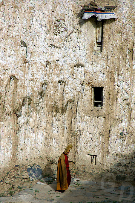 A Buddhist Monk in an ancient monastery in Tibet, northern Tibet