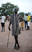 SOUTH SUDAN, Lakes State, village Mapourdit, Dinka celebrate harvest festival , posing  man with dress and spear/ SUED-SUDAN  Bahr el Ghazal region , Lakes State, Dorf Mapourdit , Dinka feiern ein Erntedankfest, posierender Mann mit Kleid und Speer