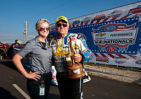 Sep 2, 2019; Clermont, IN, USA; NHRA funny car driver John Force celebrates with NHRA employee Hannah Rickerts after winning the US Nationals at Lucas Oil Raceway. Mandatory Credit: Mark J. Rebilas-USA TODAY Sports