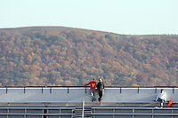Nov 13, 2010; Charlottesville, VA, USA;  Mountains looms behind fans in empty stands during the Virginia Cavalier vs Maryland Terrapins game during the 1st half of the game at Scott Stadium.  Mandatory Credit: Andrew Shurtleff-