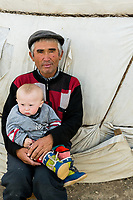 Mongolia, Bayan-Ulgii, Ulgii, Altai Mountains. Man and baby.