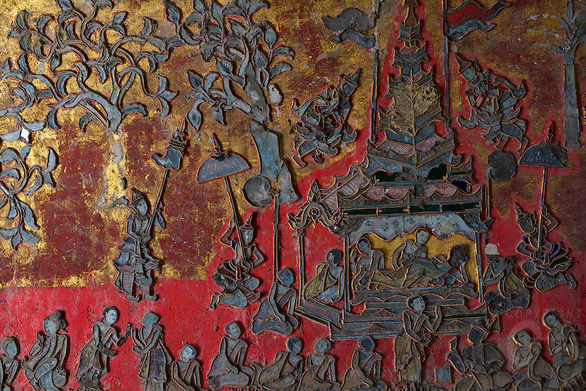 Intricate artwork on the walls in a building next to the Shweyanpyay teak wood Monastery and pagoda Inle lake, Shan State, Myanmar/Burma