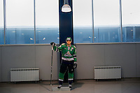 A portrait of Vitali Proshkin, team captain of hockey team Salavat Yulaev Ufa, stands in the lobby of the newly built hockey stadium in Ufa, Bashkortostan, Russia.